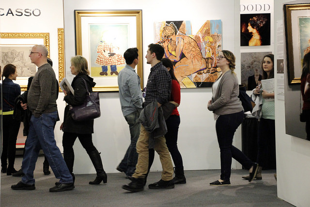 The Artexpo crowd strolling by the Masterworks Fine Art booth.